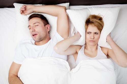 Snoring man and young woman. Couple sleeping in bed-img-blog