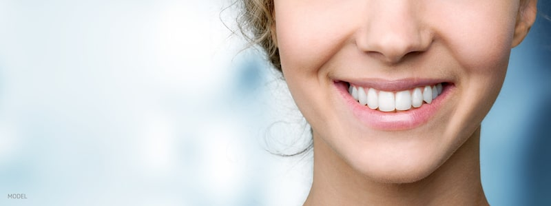 Close up image of smiling woman with white teeth.